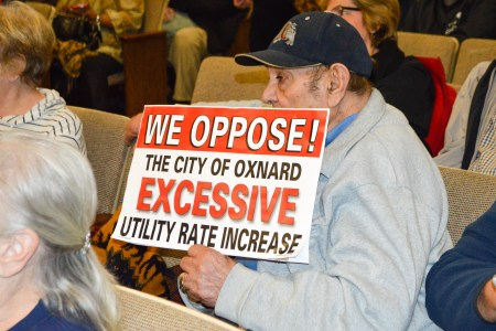 An opponent of a possible water rate increase shows his dissatisfaction.
