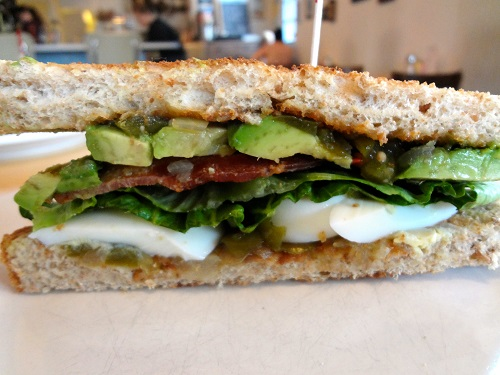 bacon, hard boiled egg, green tomato relish, lettuce, and avocado on toasted wheat