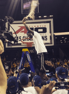 Briante Weber celebrates VCU's A-10 title by cutting down the nets.