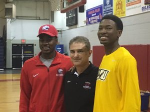 Crowfield (right) with Riverside Academy teammate Herb McGee and head coach Tim Byrd.