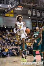 Justin TIllman earned his first All-Conference selection while averaging 12.8 points and 8.4 rebounds as a junior.