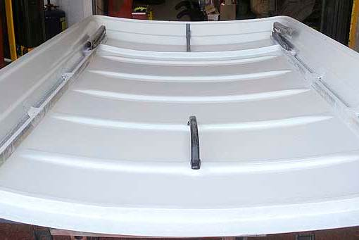 After the preparation, comes the sprayed final top coat to complete the final transformation