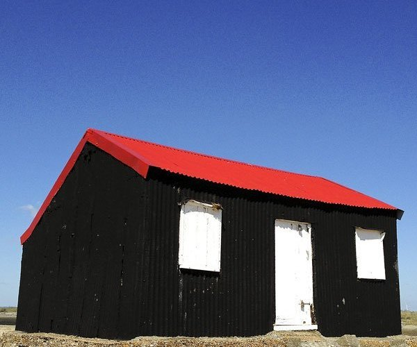 Red and black corrugated metal hut
