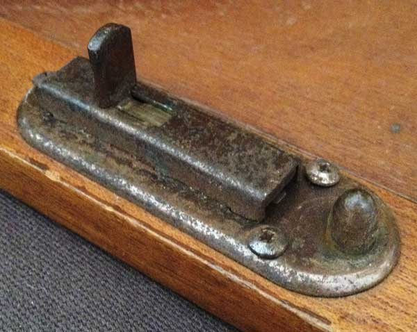 an existing Canterbury Pitt door catch that can be re-used for the table fixing bolt