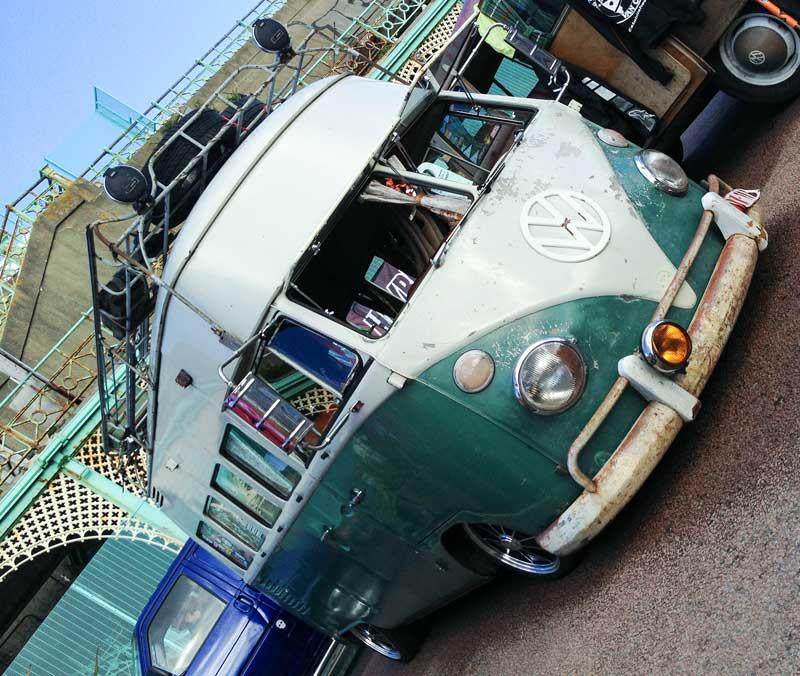 a very cool looking high top split screen bus
