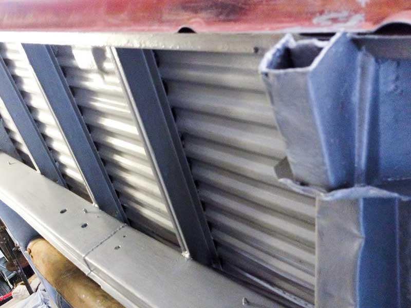 the aluminium coloured Epoxy Mastic transforms the underside of the bus