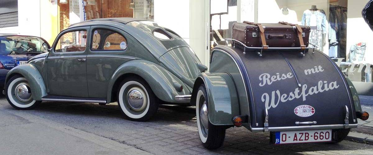 does it get any cooler than this split window ragtop bug and Westfalia trailer combo