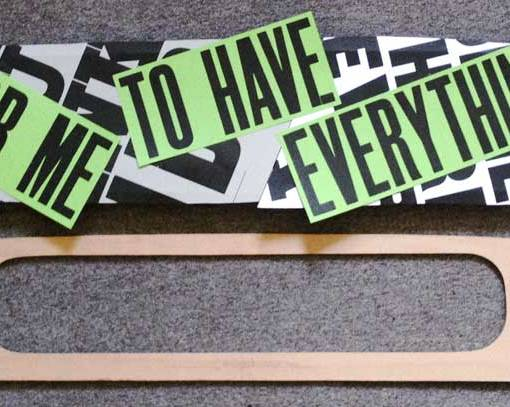 three Anthony Burrill letterpress posters cut up for the locker front