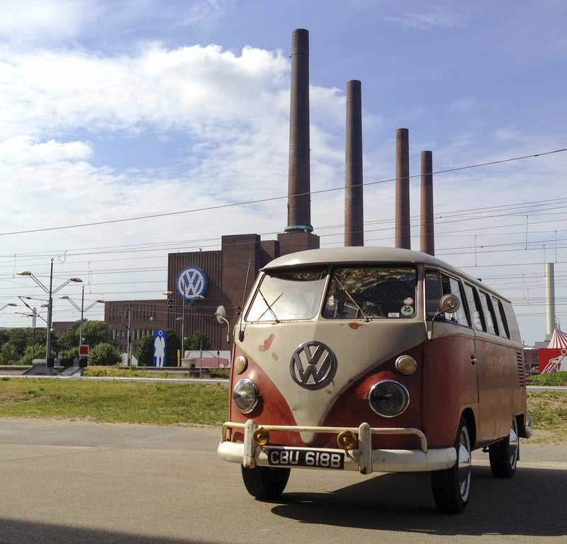 in front of the iconic VW Wolfsburg factory chimneys