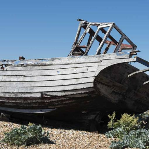 an abandoned fishing boat on the shingle of Dungeness