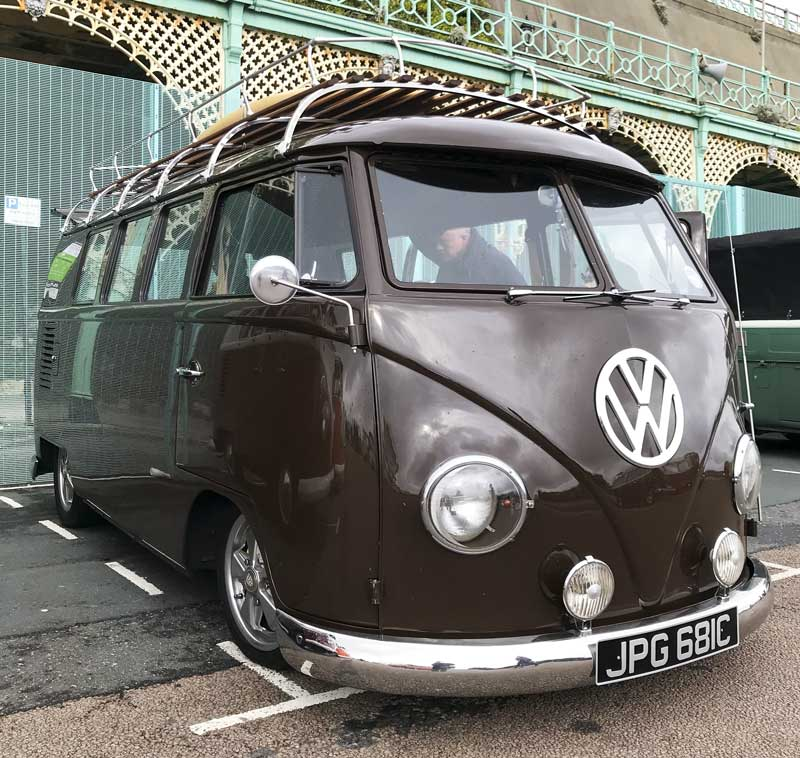 a nicely detailed bus with full length polished stainless steel roof rack