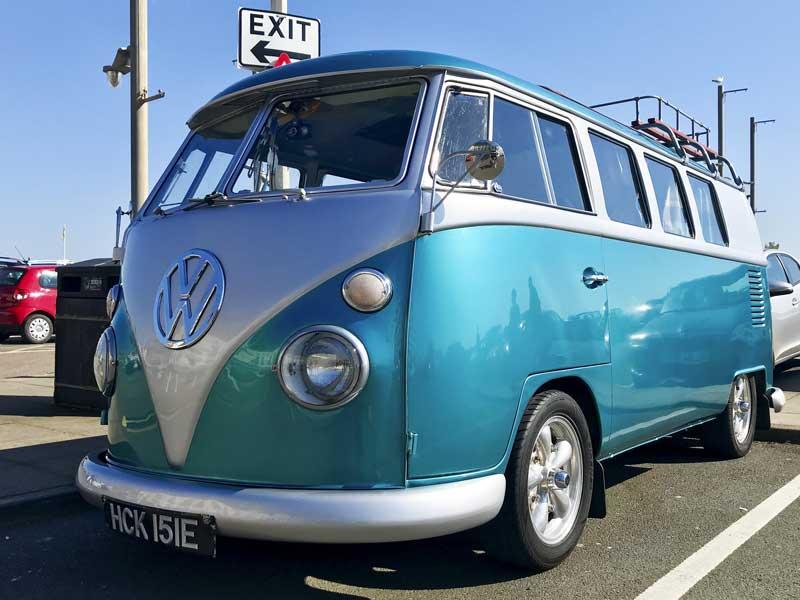 a very funky custom bus gleaming in the sun