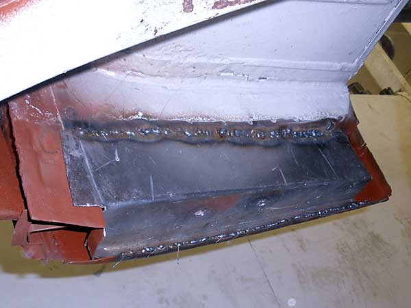 Replacement metal is welded back in to rebuild the cab step structure