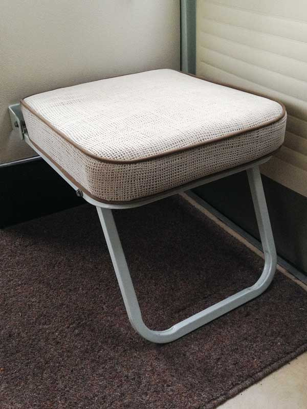 A handy fold up 'buddy seat' by the cargo doors