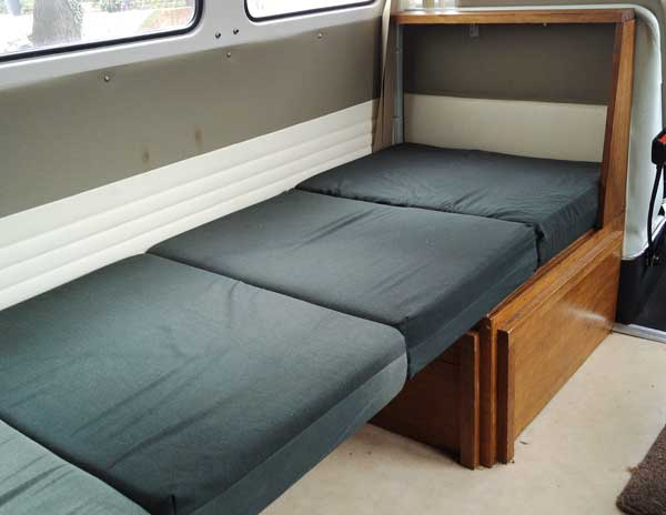 four cushion arrangement to make a day bed/child's single bed