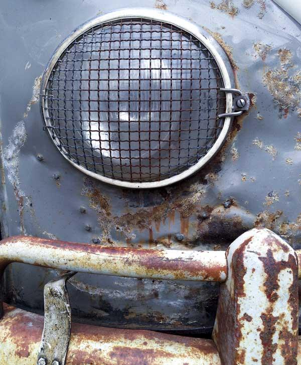 headlight detail from a beautiful battle scarred sub hatch Westfalia camper