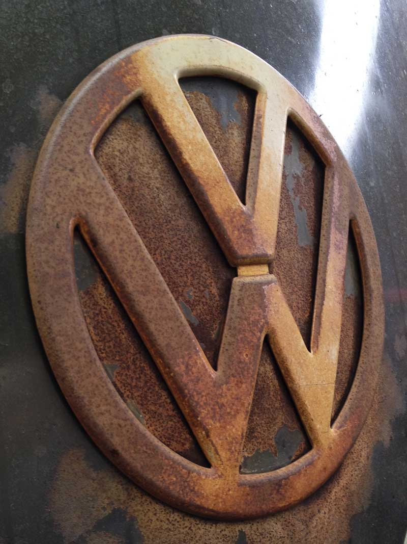 beautiful character aged rusty VW front badge on this split screen bus