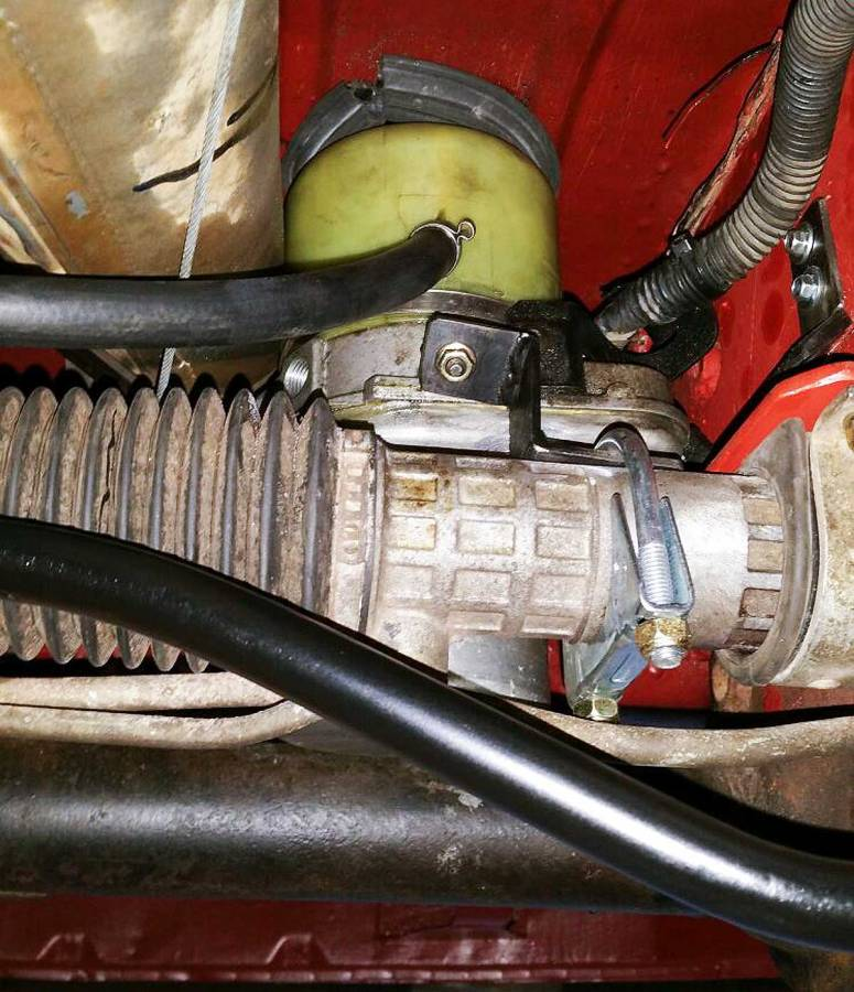 custom power assisted steering hydraulic reservoir fits neatly under front seat well