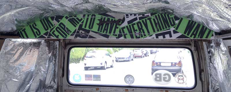 the punk/grunge style typography overhead locker finally in the bus