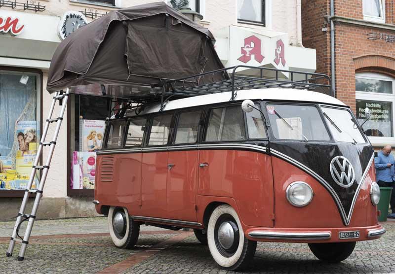 brilliant 15 window Barndoor bus with extra room on top for sleeping