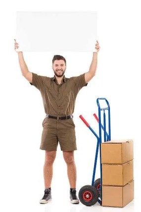 A professional fine art mover from New Jersey holding a wrapped painting, standing next to a few boxes on a cart,