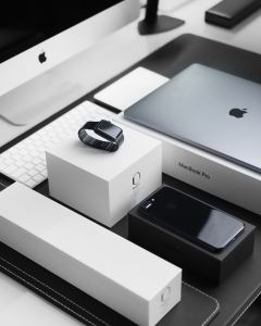 iPhone, Apple watch and a MacBook lying on a table