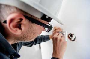 Electrician repairing the electric socket