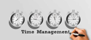 Four stopwatches with Time Management written below.