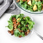 This easy vegan salad is bursting with delicious roasted sweet potatoes, crunchy kale, candied walnuts, and a drool-worthy creamy almond dressing. Enjoy! #veganrecipes #veganfood #recipeoftheday #salad #saladrecipe