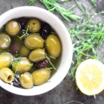 Every good hostess knows delicious marinated olive recipes are what every party needs! Save this for their next party now. This recipe is perfect. Simply serve with a bottle of wine and pita for the ultimate appetizer everyone will love. #olives #recipes #recipeideas #recipeoftheday