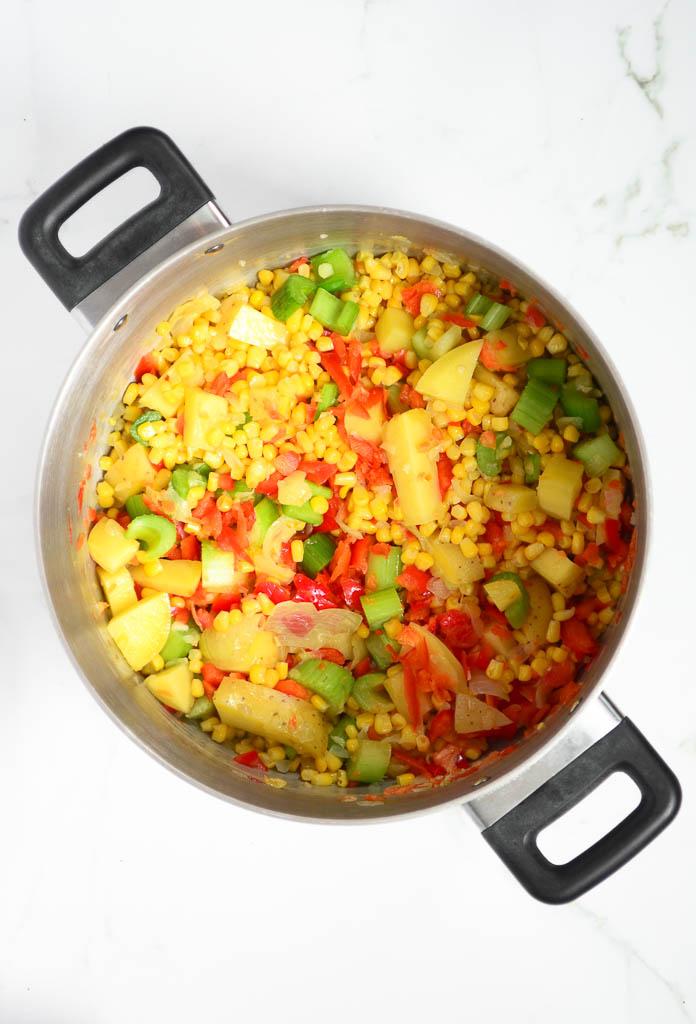 This creamy vegan corn and potato chowder is perfect for dinner on crisp autumn evenings! Ready in under 30 minutes. #cornchowder #recipeideas #veganrecipes #veganfood