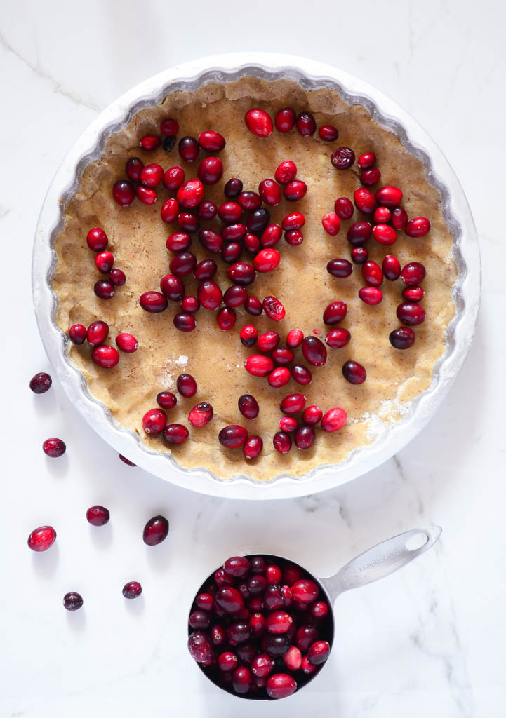 This recipe for the Ultimate Vegan Cranberry Custard Tart tastes perfectly refreshing and sweet. Bake it for your next holiday party, it's sure to be a crowd-pleaser! #vegancustardrecipe #vegancustardpie #vegancustardtart