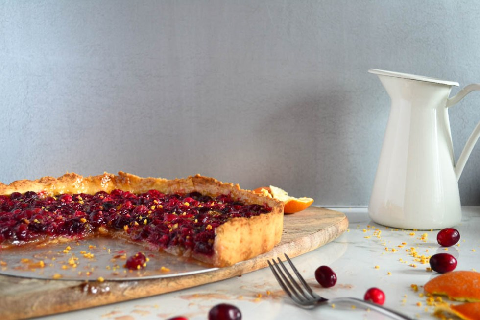 Our vegan holiday dessert recipes are some of the best around! We taste-test each recipe a minimum of 5 times before adding the recipe to the blog. This Cranberry Tart with a delicious macadamia nut crust will blow your mind. It's perfect for all your holiday parties. Plus, it's so simple to make!