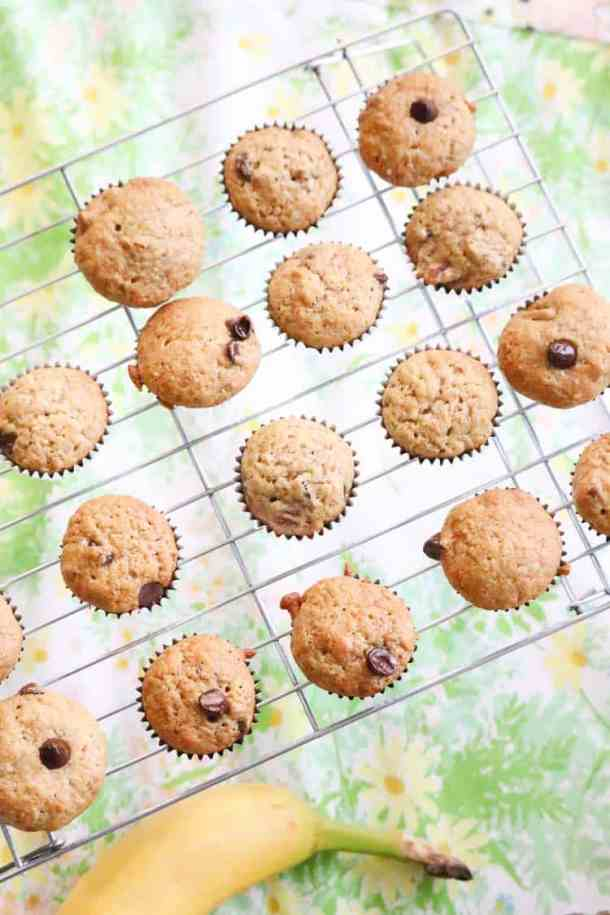 A Vertical View of Banana Bread Chocolate Chip Mini Muffins with Banana beside.