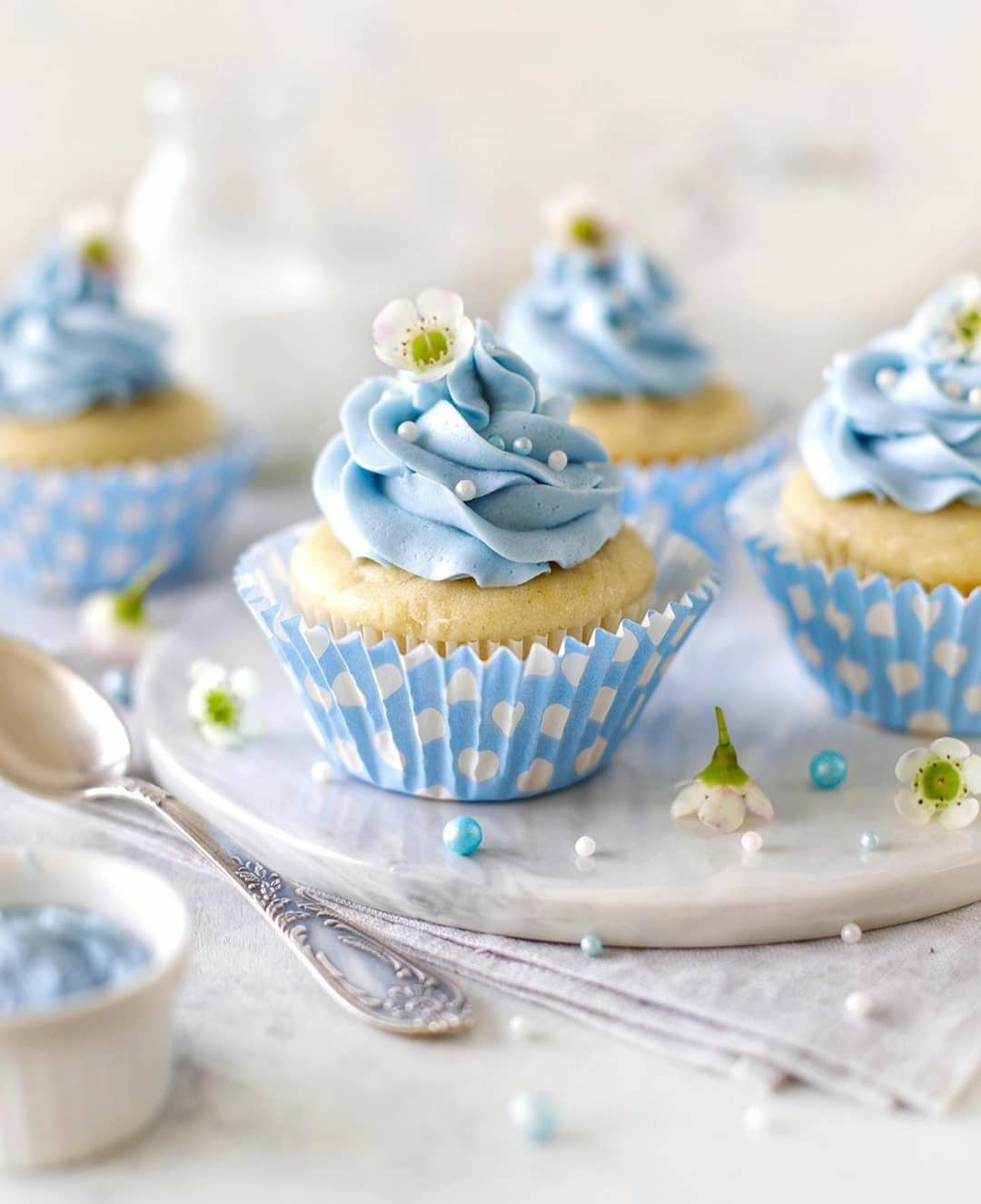 beautiful lemony muffins with sky blue spirulina frosting by display image  09a4ef8e