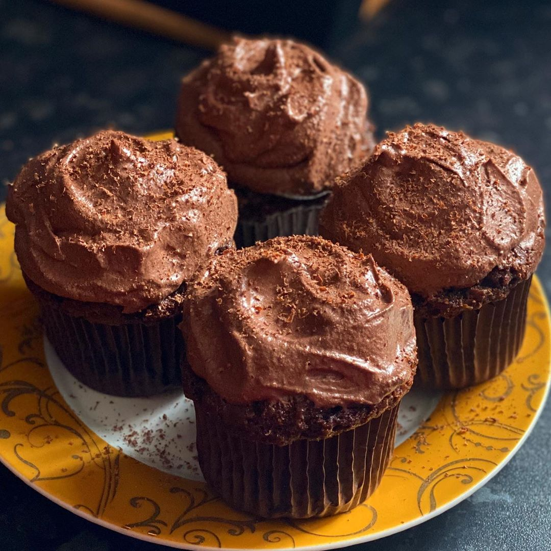 the easiest classic choc cupcakes topped with the richest an display image  548e699f