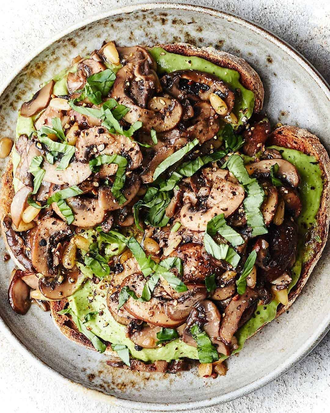 loaded avocado toasts topped with garlicky mushrooms fresh display image  d2b42ddd