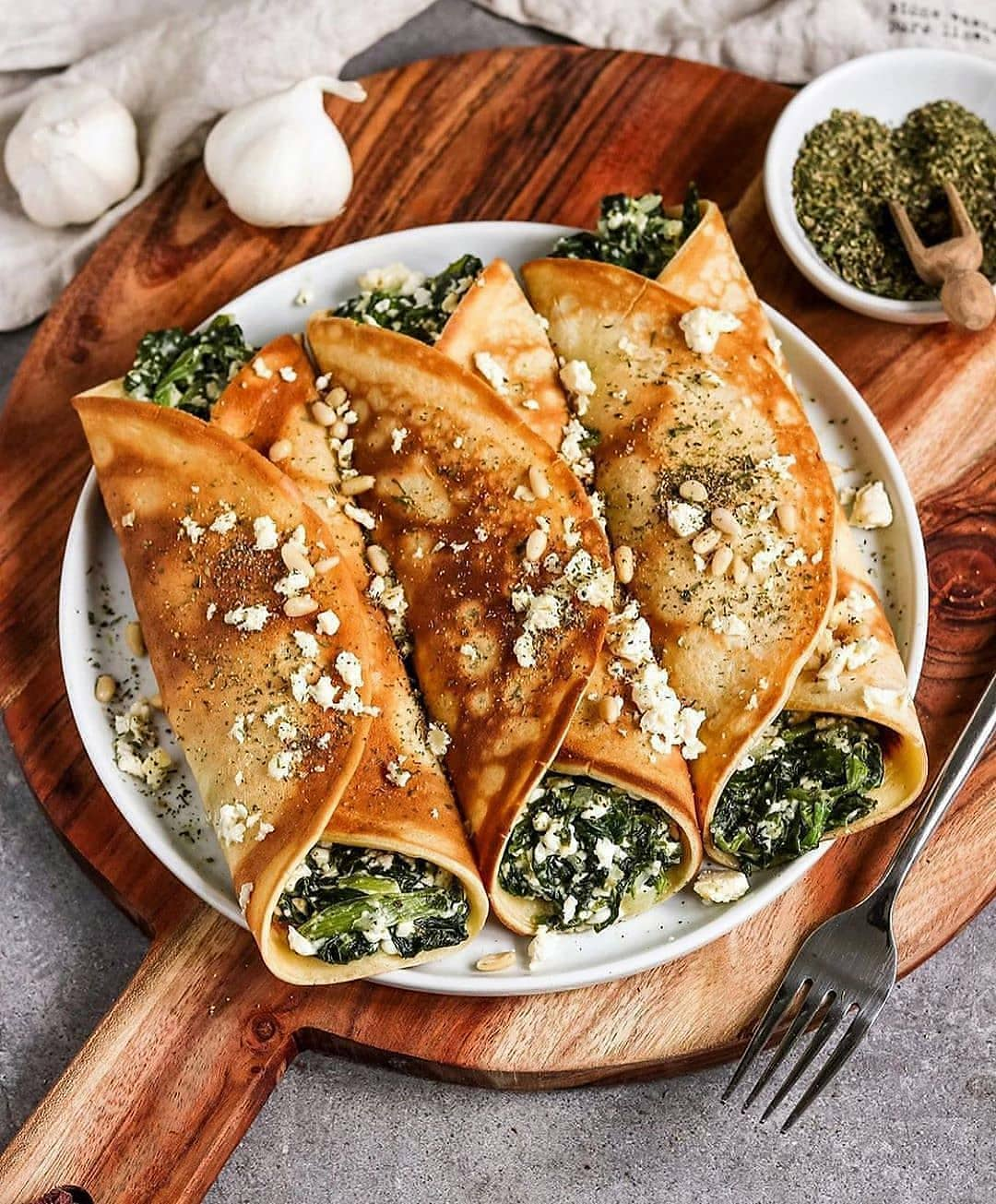 vegan oven baked filled crepes with spinach and feta by bya display image  8a414a95