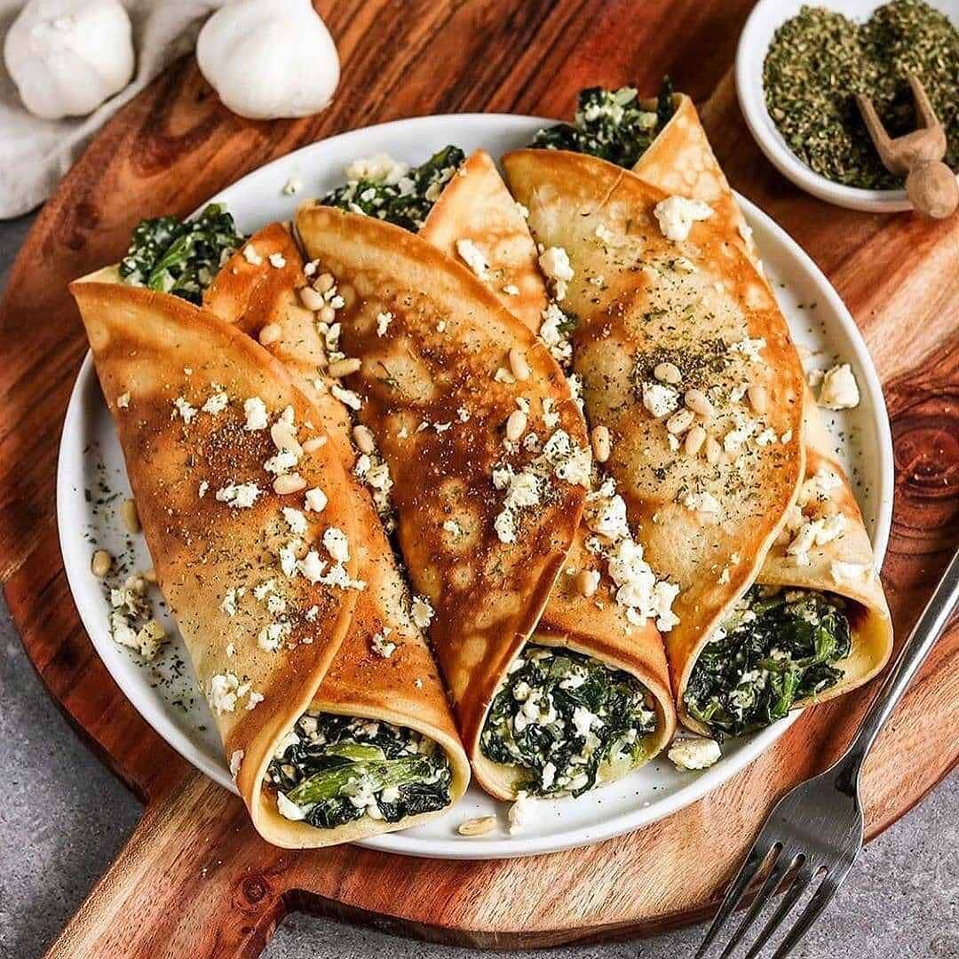 vegan oven baked filled crepes with spinach and feta display image  d45021c5