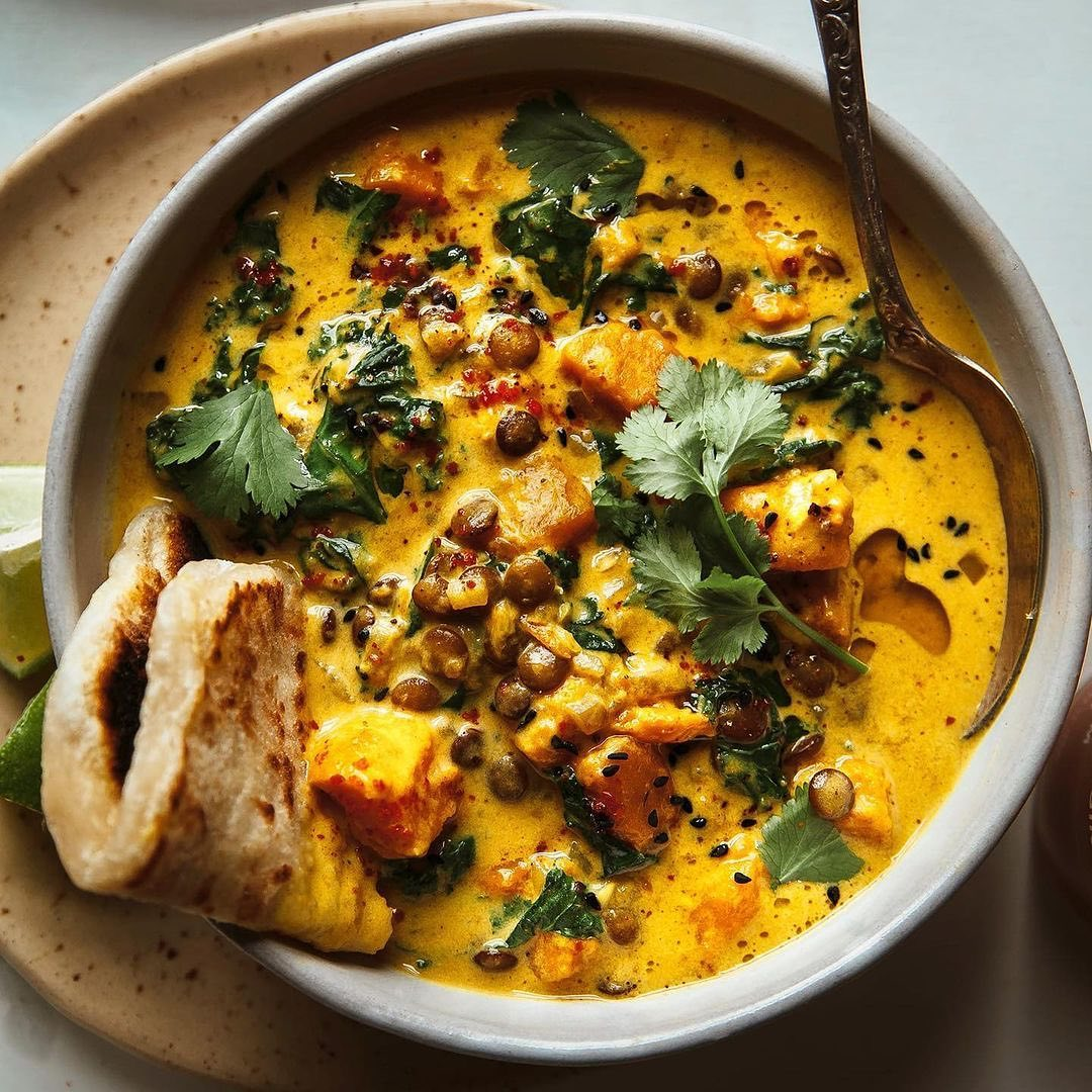 sweet potato and coconut milk stew with lentils and kale by display image fa