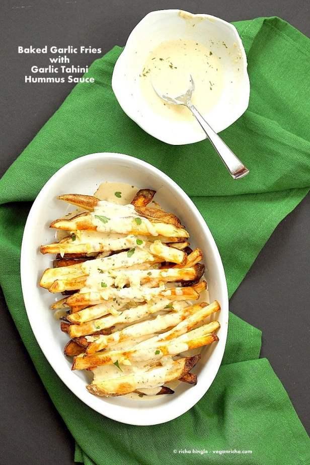 Baked Fries with Garlic Sauce - Russet potato baked and drenched in tahini hummus lemon sauce | VeganRicha.com #vegan #appetizer #glutenfree #soyfree #recipe