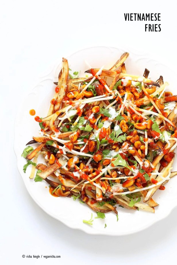 Baked Vietnamese fries. Baked Potato strips, loads of cilantro and basil, bean sprouts, nuts in sweet chile sauce, sriracha and vegan mayo! Banh mi Sandwich in fries form. Vegan Gluten-free Recipe. | VeganRicha.com