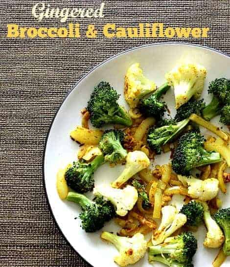 Gingered broccoli and cauliflower recipe - a delicious and healthy vegetable side dish recipe with roasted broccoli and cauliflower, tossed with ginger and curry spices for a delicious, rich Indian-inspired flavor. | vegan side dishes | vegan side dish recipes | broccoli side dish recipes | cauliflower side dish recipes | curried vegetables | curried vegetable recipes | #vegansidedishes #vegetablerecipes #vegetablesidedishes #healthyrecipes #healthyeating #wfpbrecipes #sidedishrecipes
