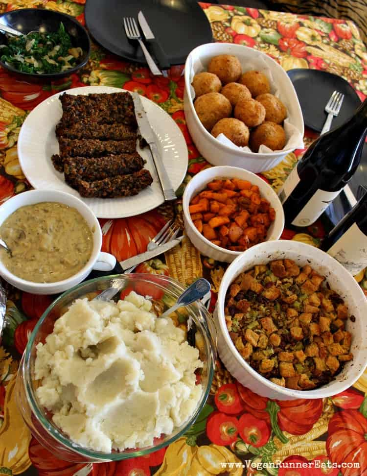 A vegan Thanksgiving table spread including sausage-stuffed Italian rice balls.