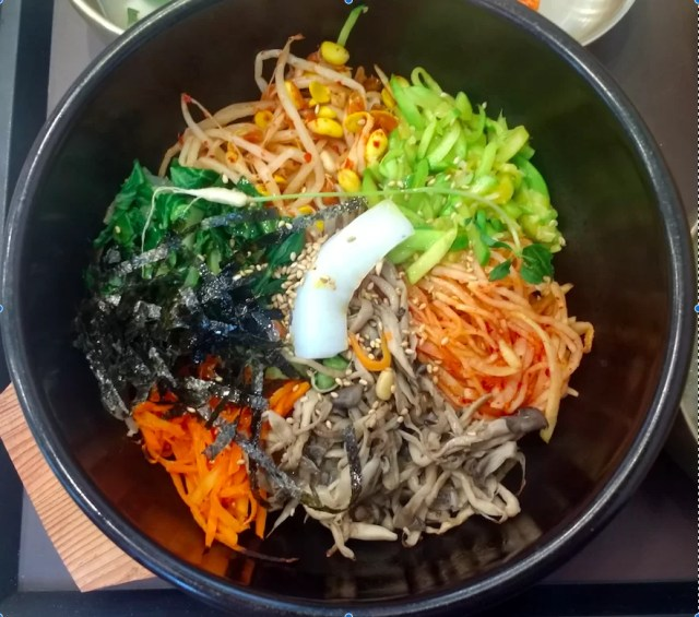 Korea's famous dolsot bibimbap - food easily made vegan by leaving out the egg