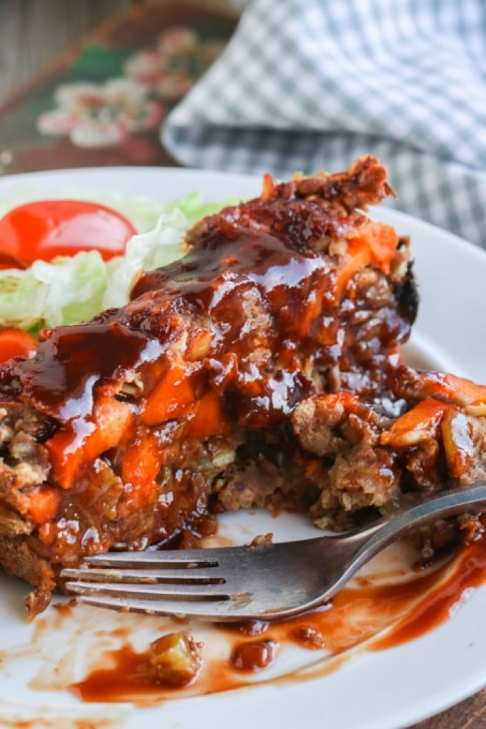 Picture of eaten slice of vegan lentil loaf on white plate