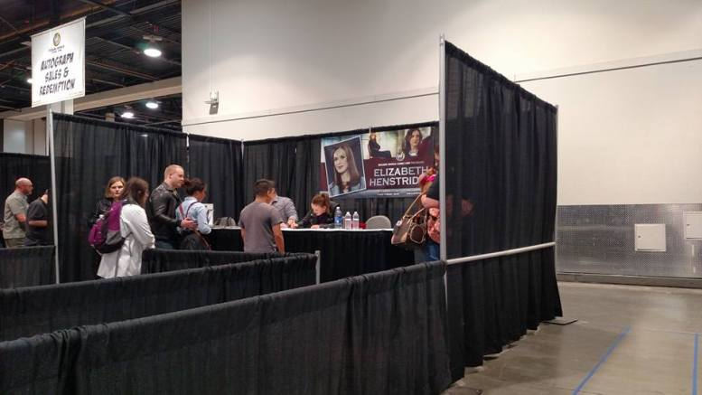 The booth for Elizabeth Henstridge, with Ralph getting her autograph