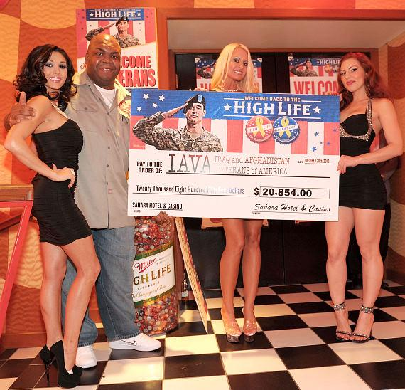 High Life delivery guy Windell Middlebrooks with Sahara's contribution check