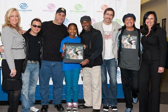 Carlos Santana with band members, Imani, and staff of Lied Memorial Clubhouse