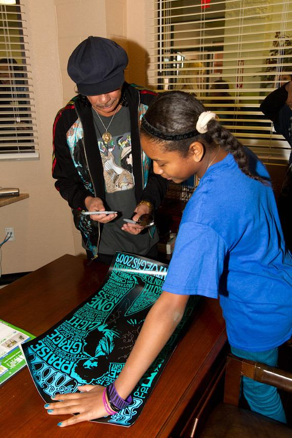 Imani shows Carlos another piece of artwork